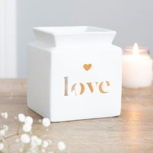 Picture of a White Ceramic Oil and Wax Melt Burner, with the word 'Love' cut out