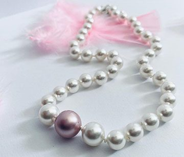 white on pink pearl necklace