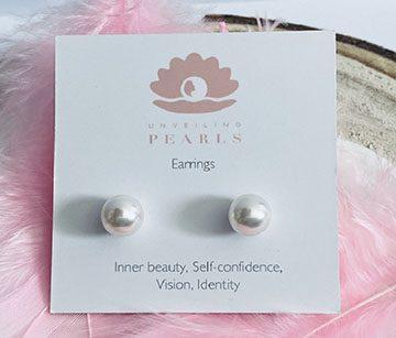 White Swarovski pearl stud earrings