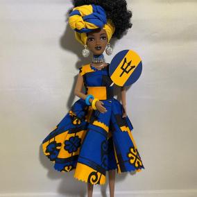 Beautiful black doll in Barbados Barbadian Bajan traditional flag colours