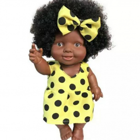 Black Baby Doll with Brown Skin and Afro Hair wearing a spotty denim dress African Jamaican Ethnic